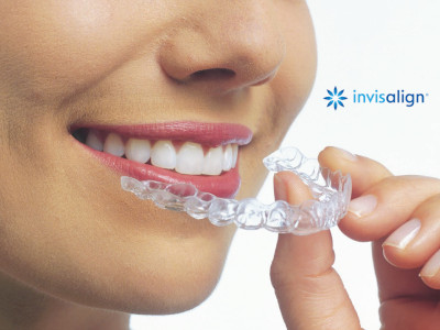invisalign and smiling woman